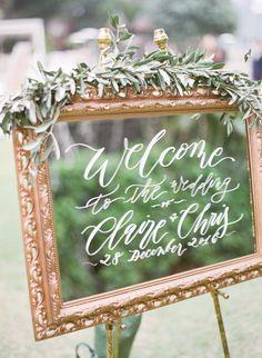 Elegant gold framed mirror wedding sign: http://www.stylemepretty.com/2017/04/13/classic-hong-kong-wedding/ Photography: Hilary Chan - http://www.hilarychanphotography.com/