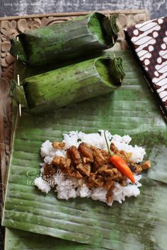 Coconut Rice Filling Wrapped In Banana Leaves