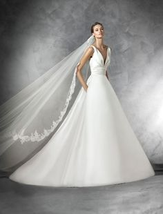 Structured A-line wedding gown with pockets!