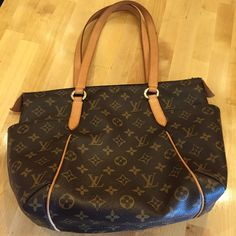 % Authentic LV Totally pm Authentic Louis Vuitton Totally PM in good condition. Made in USA Datecode SD4160 come with dust bag only. Beautiful patina on handles. Clean inside and out. There's scuffs mark on the bottom leather trim but will be very easy to clean. Sold as is. Louis Vuitton Bags Totes