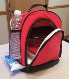 Insulated Lunch Bag by Sacko! It's GREAT! The large zippered compartment is perfect for a sandwich, chips, extra soda, etc. I can put a couple of different Tupperware containers in it. Pretty good size for all you need. On the bottom, is a second zippered compartment that you can slide a small container into or an ice pack. There is a netted water bottle holder on the side which comes in handy. Perfectly sized! I received this product free for my review, but my opinions are my own. #Sacko