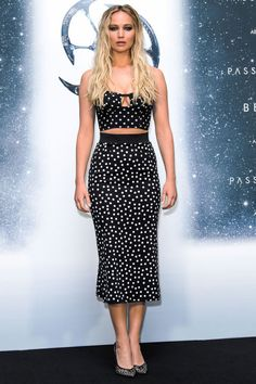2 December Jennifer Lawrence wore a polka dot co-ordinating bralette and midiskirt to the Berlin premiere of Passengers.