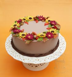 Autumn cake with flowers and berries