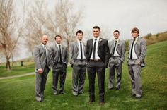 groomsmen in medium gray and groom in dark gray by GreciaParra
