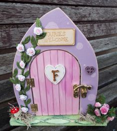Custom made to order and decorated by hand. Can be personalised. by KatijanesCreations on Etsy Painted Rocks Craft, Painted Stones, Wooden Wreaths, Fairy Crafts, Fairy Doors, Autumn Wreaths, Rock Crafts, Painted Doors, Tooth Fairy