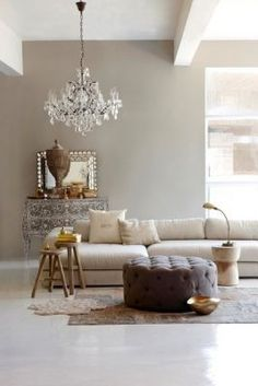 open living space : light palette, low contrast, chandelier. gold tones.