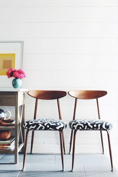 A set of six mid-century modern dining room chairs with African print upholstery. These unique chairs are vintage made of solid wood and metal legs with upholstered, brand new cushions.