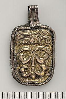 Viking Age; Uppland; silver, gold plating pendant cut from the edge of  ornamented silver vessel. Bäröglan missing.