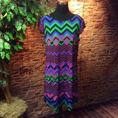 SZ 14 GORGEOUS Madison Leigh Dress This gorgeous dress has vibrant colors and a bold pattern. Layer a cardigan on for all season wear Madison Leigh Dresses Mini