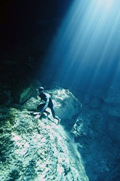 The depth of these cenotes are elusive due to the swirling white halocline that hovers at 30 meters, a chemical reaction between layers of fresh and salt water through which the sunlight barely penetrates and the dark depths lie beneath.