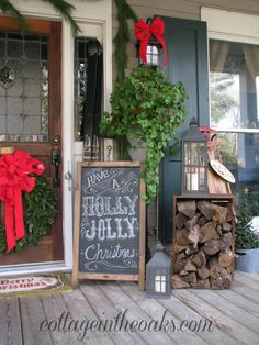 Christmas porch.  I love how she stacked wood, in the box.  Would be a decorative way to keep wood, for the stove, near the front door.