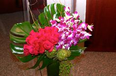 Beautiful contemporary floral arrangement with roses and orchids. www.the-petal.com