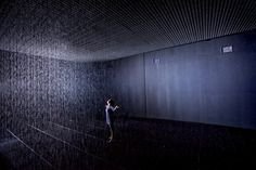 Art Review: Rain Room @ The Curve, Barbican Centre | Londonist  it tracks your movements so you don't get wet, even as you walk through rain!