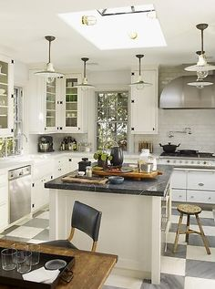 WSH loves this white kitchen with black accents. Via Steven Gambrel.