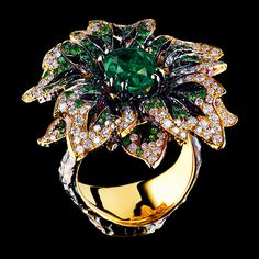 Windflower Ring ~ Set with one emerald of 1,83ct, tsavorites and diamonds in yellow gold