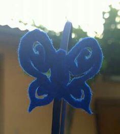Diadema rígida con mariposa calada