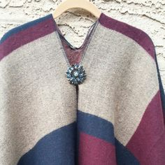 Wrap yourself up in this soft cozy blanket/poncho.