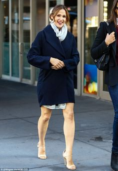 Beaming: She smiled from ear-to-ear during the stroll in the Big Apple...