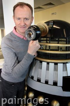 Mark Gatiss poses with a Dalek during a photo call at Teesside University, as the actor and screenwriter who has previously appeared in Dr Who will star in the Dad's Army remake playing Captain Mainwaring's colonel, stating that it will maintain the humour and poignancy of the original.