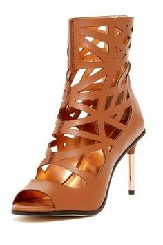 Cut-out high ankle heel.