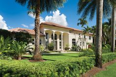 The eclectic exterior of this Bay Colony home exudes Old Naples aesthetics and belies the complete cosmetic re-interpretation within, where interior designer Bethany O'Neil neutralized a mix of styles for a seamlessly classic twist on traditional. Majestic Fireplace, Clay Roof Tiles, Treads And Risers, Iron Balusters, Florida Design, Stucco Exterior, Rose Trees, Modern Aesthetics, Green Landscape