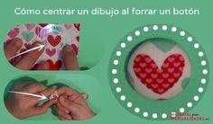 Cómo centrar un dibujo de la tela al forrar un botón.