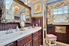 A purple bathroom is one of many bright colored rooms in this southern bell-approved house.
