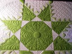 I like the puffed/raised fence pattern in the corners.  machine quilting-sewfarsewgood