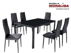 The GFW Houston Dining table comes with 6 dining chairs. This sleek dining set, with clean lines and glass topped table is sure to make an impact in your dining room. The 6 dining chairs are padded for extra comfort.