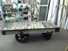 $595 - This is an Antique Dock Dolly - Great for D.I.Y. projects. The bed measures approximately 30 inches wide and 60 inches long, standing 19 inches tall. ***** In Booth H18 at Main Street Antique Mall 7260 E Main St (east of Power RD on MAIN STREET) Mesa Az 85207 **** Open 7 days a week 10:00AM-5:30PM **** Call for more information 480 924 1122 **** We Accept cash, debit, VISA, Mastercard, Discover or American Express