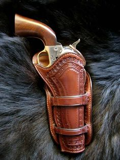 Borderstamped Dickerson holster by Purdy Gear Custom Leather Goods.