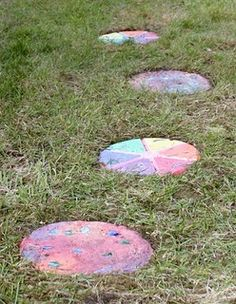 Homemade Stepping Stones...mix concrete, and paint when dry. Fun!