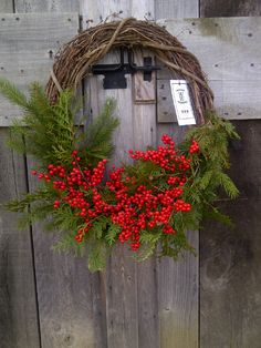 This holiday wreath is simple, yet spectacular, using only evergreen boughs and Warriner Winterberry cuttings to adorn the grapevine wreath.