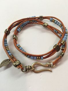 "A double wrap bracelet with blue padres beads. Very frustrating because the strand of padres beads' holes are so irregular a lot of them wouldn't take a 1 mm leather cord. Grrrr...but love the way it turned out! Going to put in my Etsy shop, JeanBeanGifts. Pattern is from Beadshop.com--""Tahoe"""