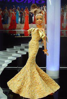 Miss Florida 2012  - El estado del sol del Sur envía esta belleza de alta costura en amarillo soleado en un vestido inspirado por Jean Louis Sabaji.