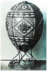 Alexander the III Commemerative Egg 1909. The egg is one of four to commemorate Alexander. It had diamond cluster, baskets, ribbons and flowers. The surprise was a miniature gold bust of Alexander on a  pedestal  This egg is one of the eight Imperial Fabergé eggs that are currently missing; and one of only two lost eggs for which a photograph exists, the other being 1903's Royal Danish egg.