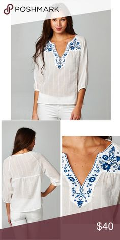 Floral Embroidered Top 100% Cotton. This half sleeve top has a floral Embroidered v neckline and semi sheer fabric. Runs true to size Tops Tunics