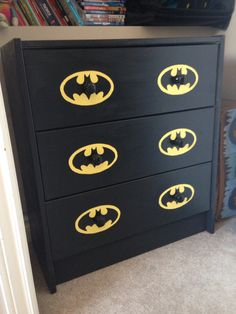 Simply ikea wood dresser painted with batman outline - son loves it !!!