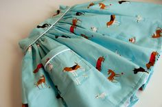 Aesthetic Nest: Sewing: Dog Skirt with Piped Pocket (Tutorial) This pin is really for the piped pocket part of the tutorial, but why don't have any of this puppy fabric in my stash?