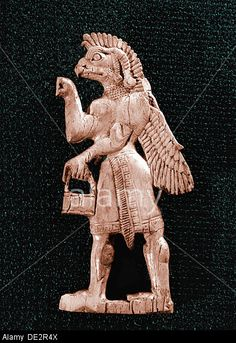 Fort Shalmaneser: an Assyrian-style ivory inlay depicting a winged, eagle-headed genie holding a situla & a cone. Shalmaneser III's royal residence & royal arsenal. Nimrud