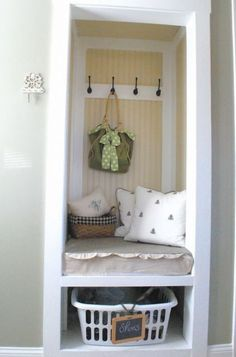 Create a mini mudroom in a closet by removing the door, then adding wall hooks, padded seating and open storage under a built-in bench. This is a great way to turn an underutilized closet into a multifunctional space.