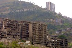 Xiling Gorge - Contrast between older apartments, to be demolished, and new housing projects higher on the hill.