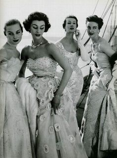 Models wearing evening gowns by Hartnell, 1953.