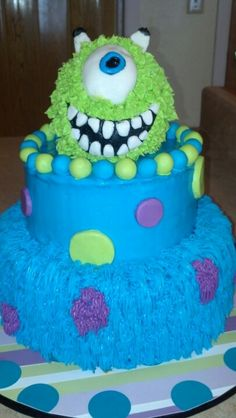 Monsters Inc baby shower cake. I wonder if we could transform this look into a diaper cake