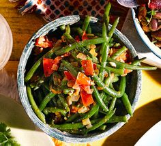 Shivi Ramoutar shares this simple, speedy side dish of green beans, onions and ripe tomatoes, which is found across the Caribbean