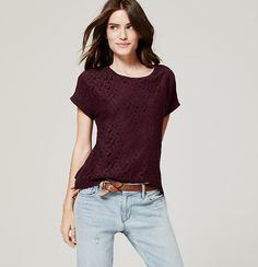 A leafy lace front romances this pure cotton tee. Jewel neck. Short dolman sleeves. Solid back. Solid trim at neckline and roll cuffs.