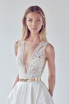 Plunge neckline echoes Golden Globe 2017 trends.  Love the simple slim gold belt.  2017 bridal collection by Suzanne Harward