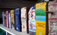 More salvaged bricks that have been painted to look like they belong in an old library. The faux literature is the brilliant work of Daryl Fitzgerald, who transforms the bricks by stenciling them on both sides with titles of literary classics.