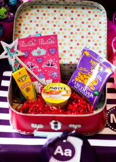 Photo: Front Room Photography // Featured: The Knot Blog...Activity Suitcases For The Kids Table