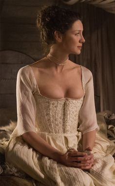 Even the corset is embroidered.